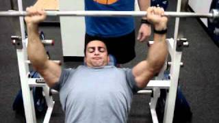 Fadi Malouf  performs a chest press exercise and gives insight on the importance of supersetting the chest and back. Workout included.